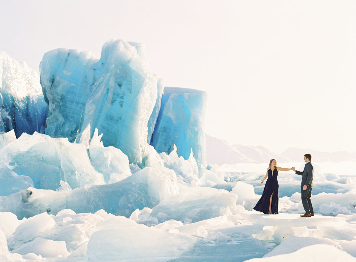 Couple dancing on Knik Glacier during engagement.
