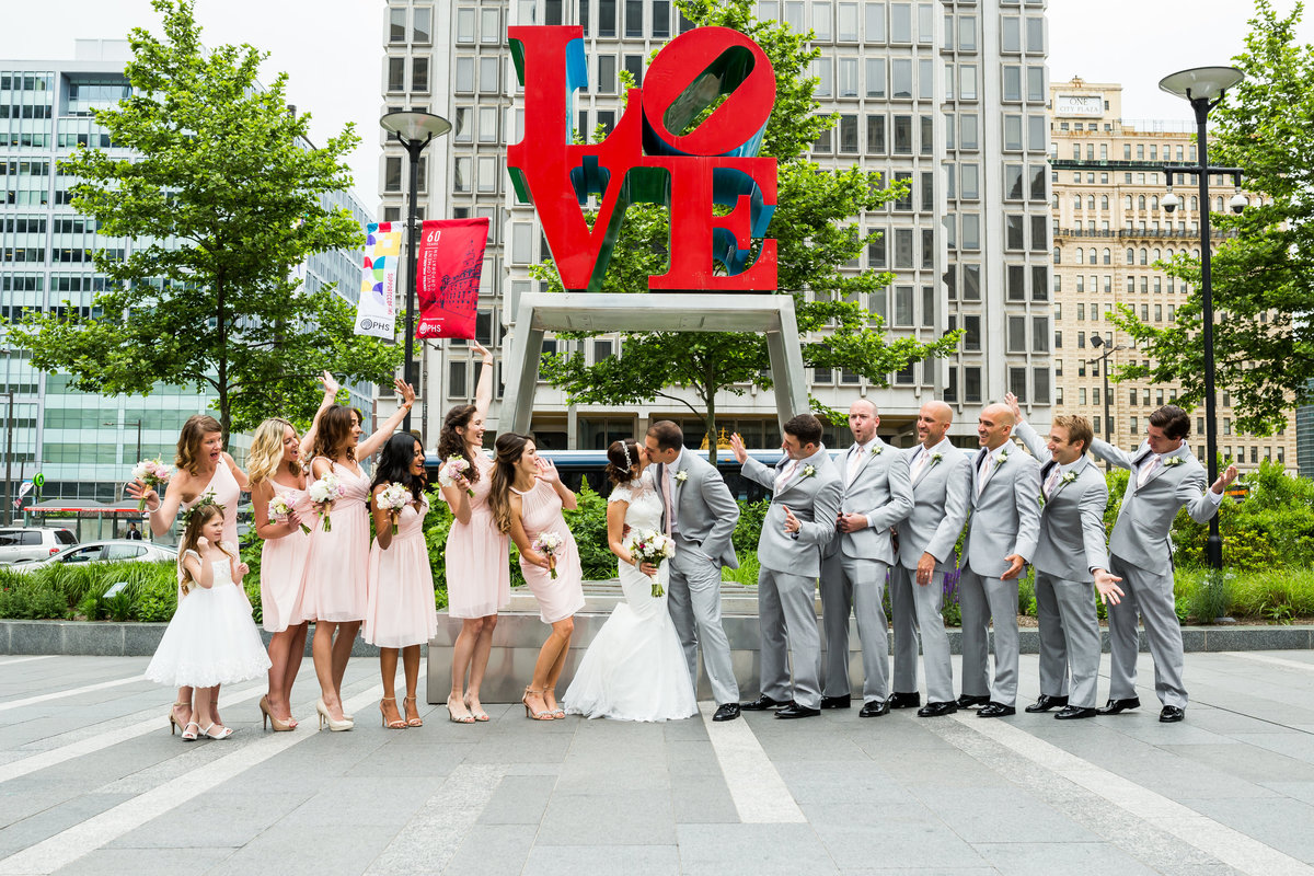 Bridal party fun group photo by the Love sign in Philadelphia PA