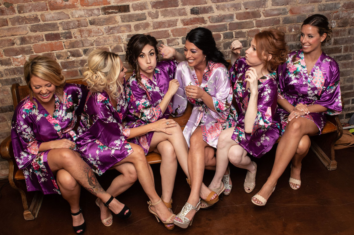 bridesmaids gather in matching robes