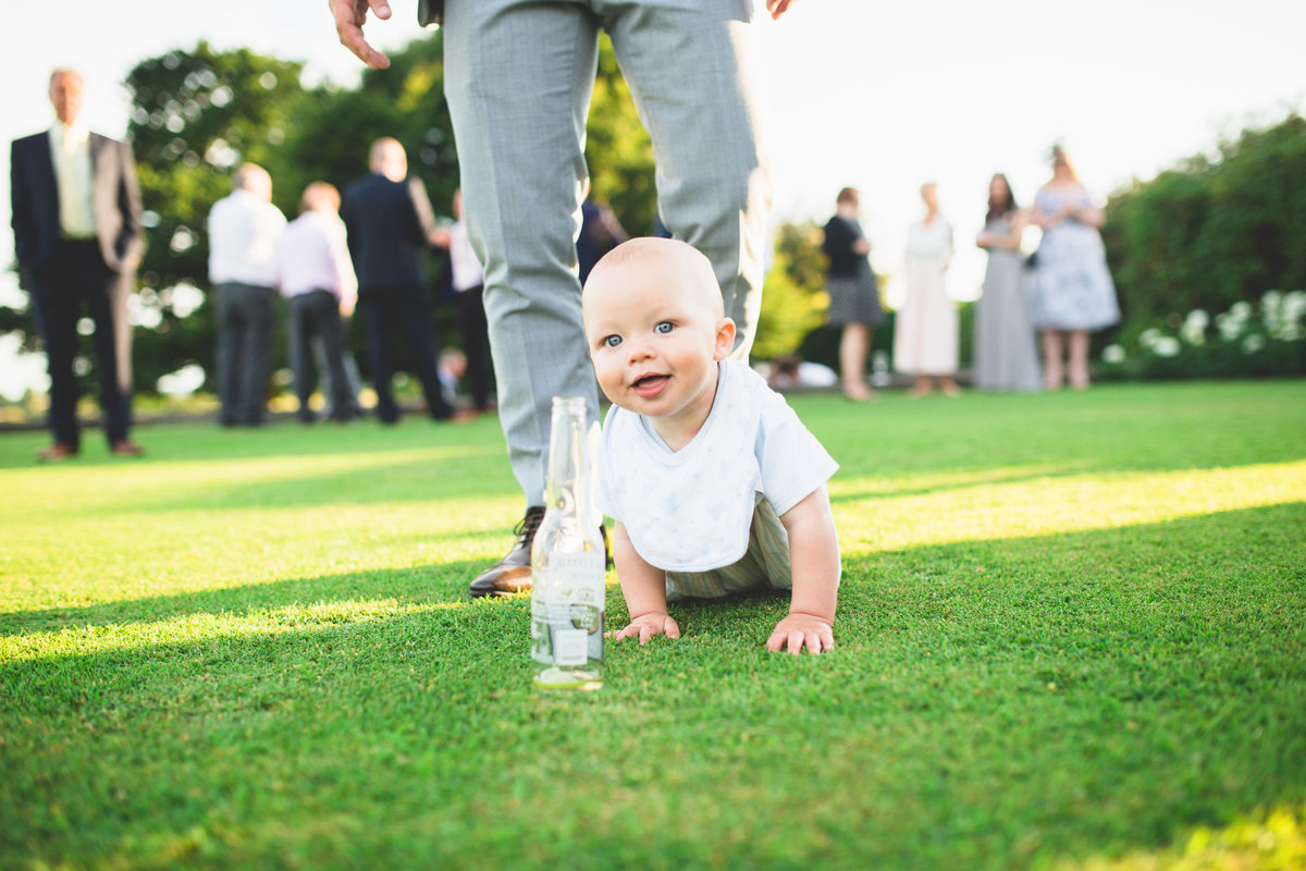 a babdy crawling towards beer during the drinks reception