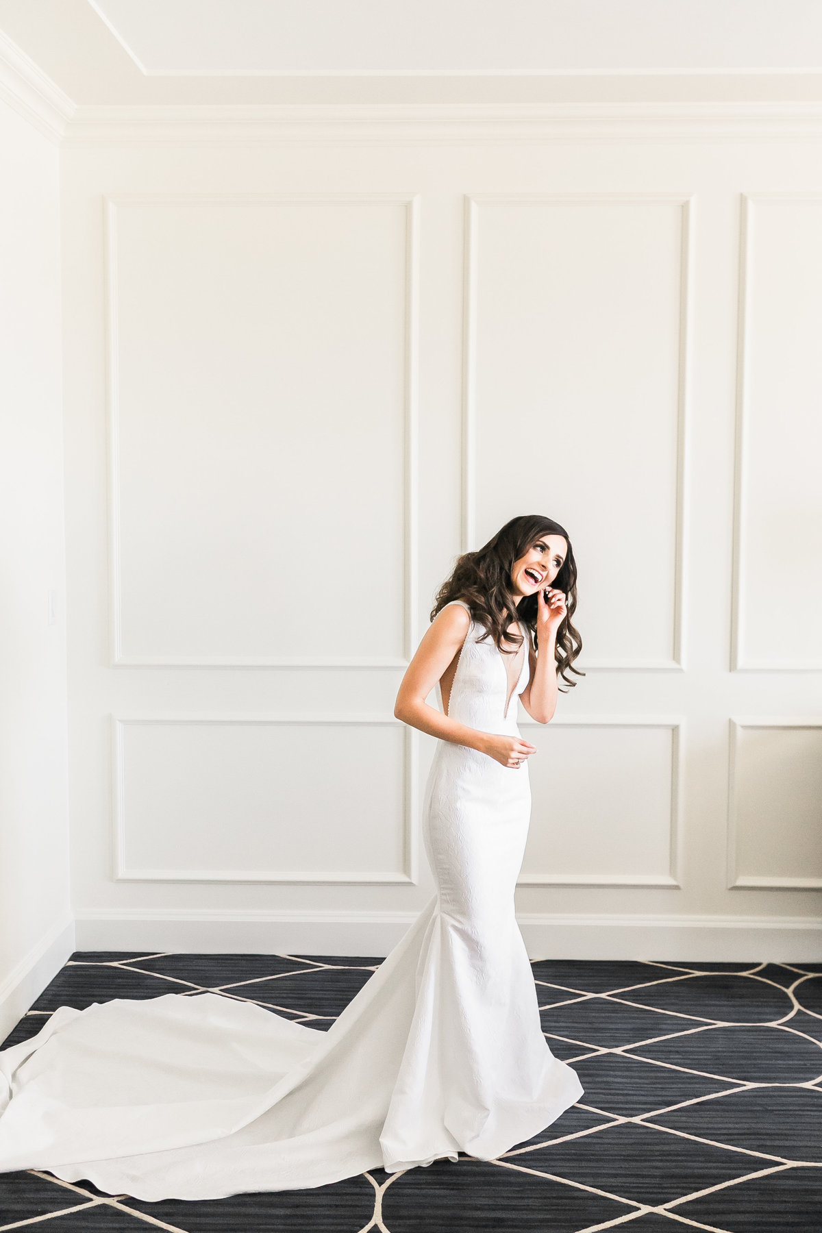 a photo of a bride getting ready for her wedding with a Pronovias Gown at a wedding at Green Valley Ranch in Las Vegas