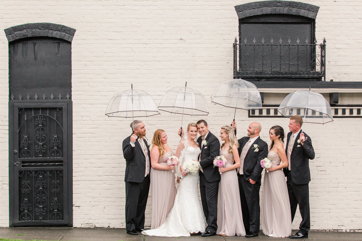 Snohomish wedding photographer rainy day wedding party with umbrellas