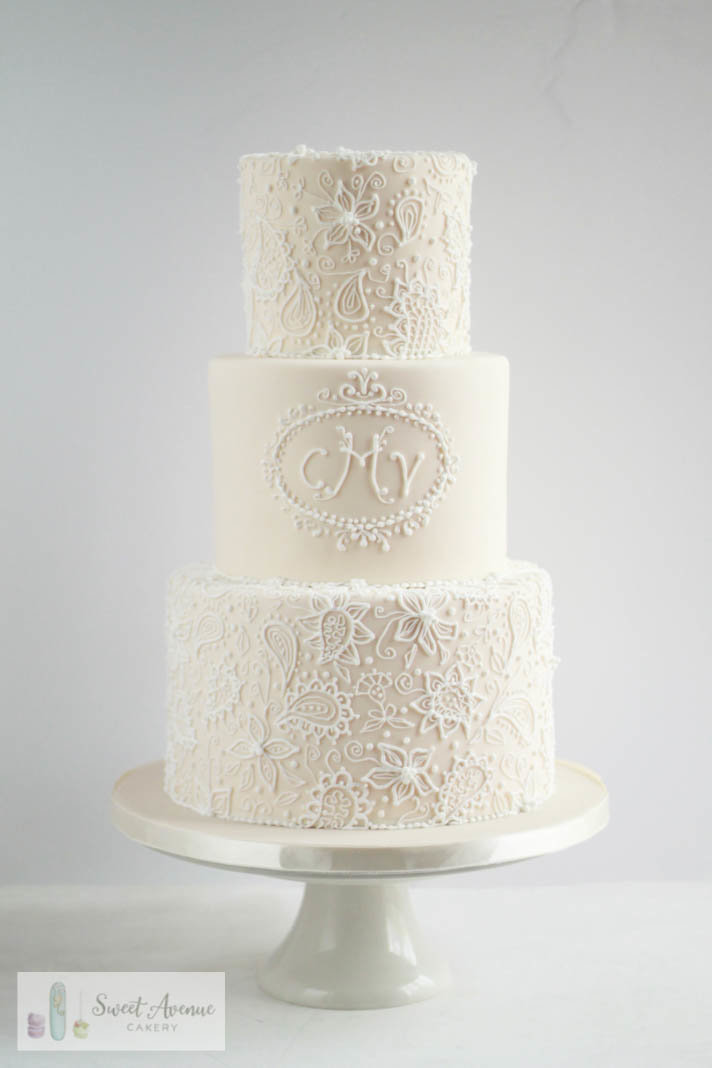 elegant piped lace all white wedding cake