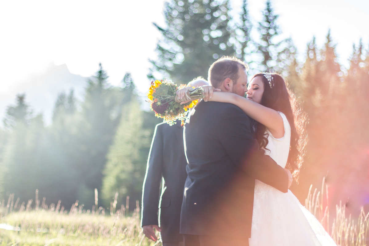 Jackson Hole, Wyoming, Teton Valley, Driggs, Idaho, wedding photographer,, ceremony, outdoors, sunny wedding session, first kiss, dreamy