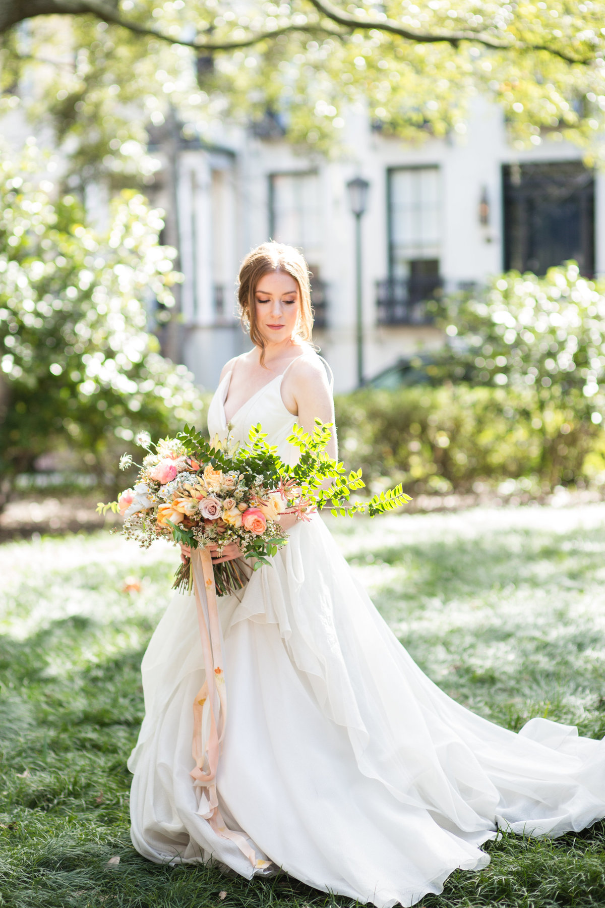 beautiful bride with bouquet at monterey square downtown savannah georgia