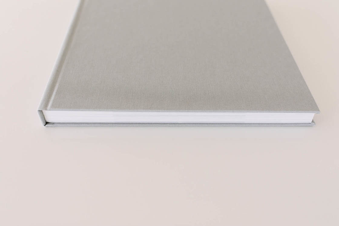 beautiful gray album laying on a white table in Boudoir by Elle photography studio