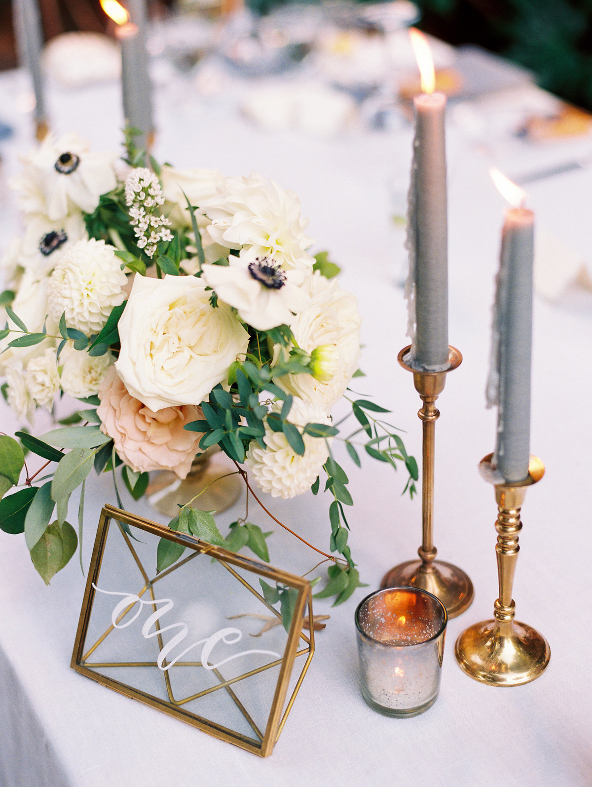 candles and flower centerpiece at a portland wedding