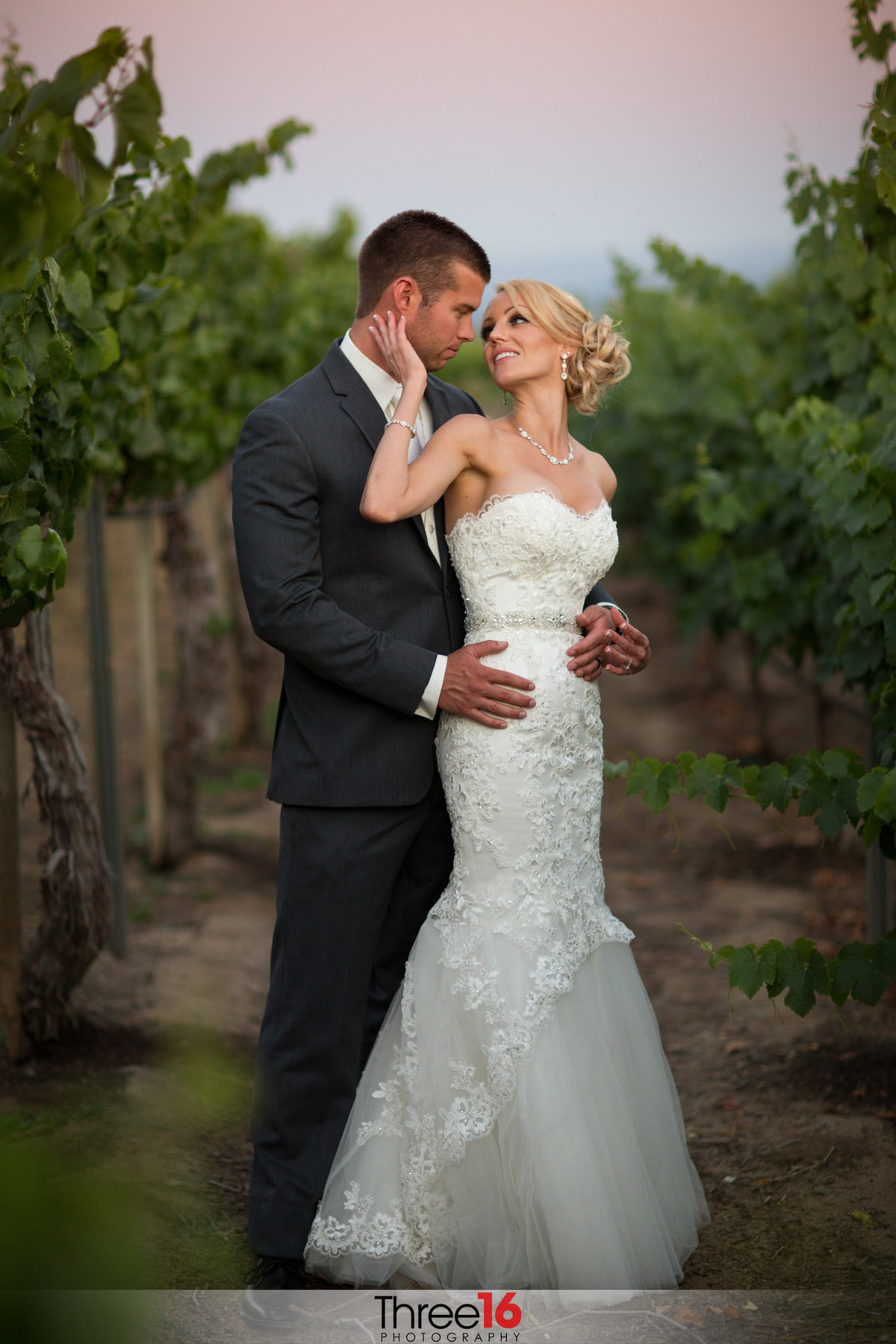 Bride and Groom share an intimate moment in the winery