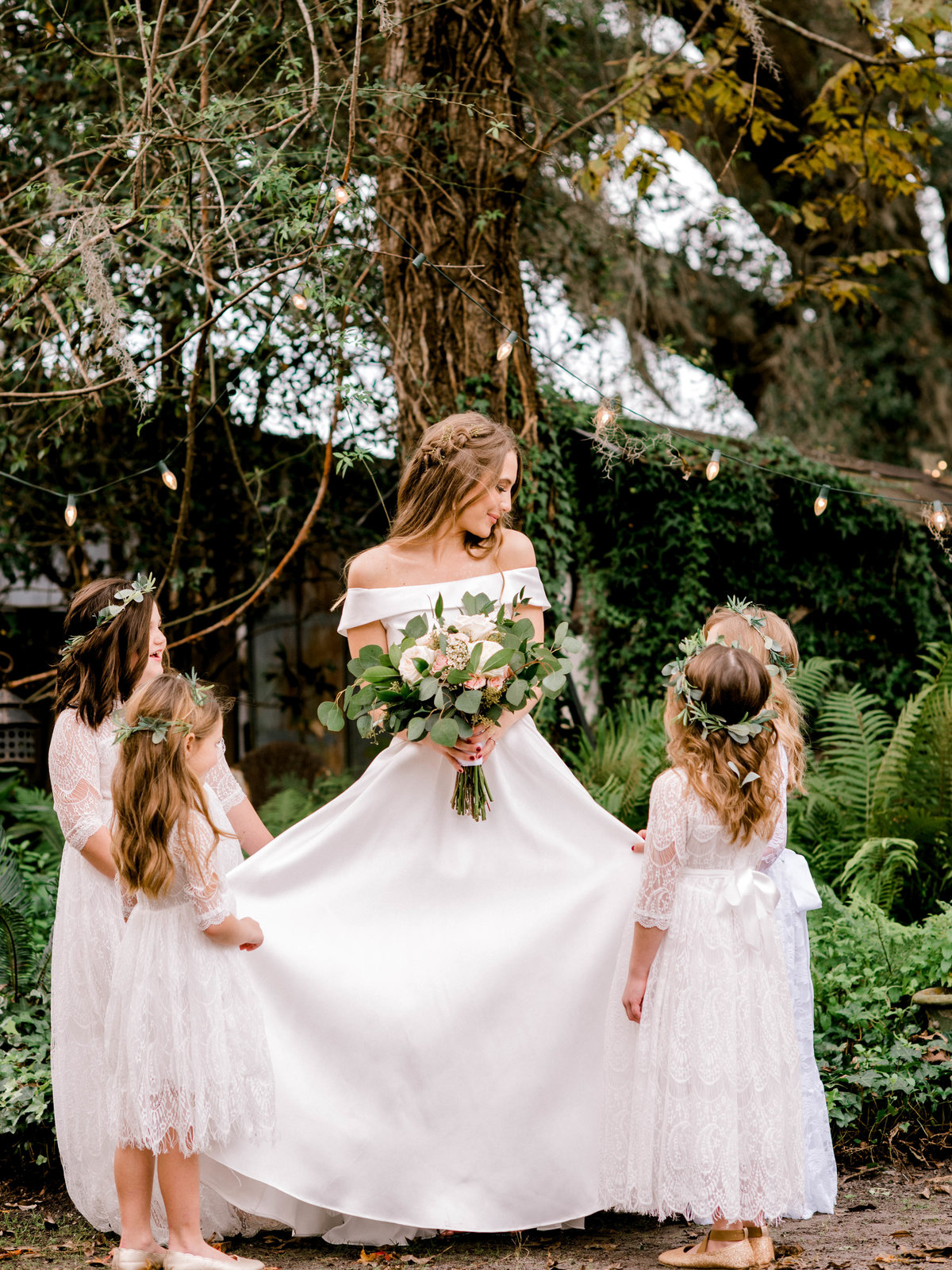 Bride surrounded by flower girls