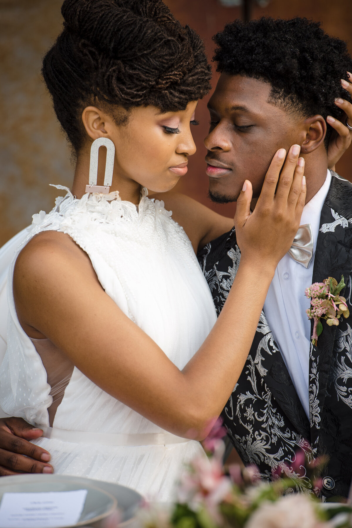 African American bride and groom romantic kiss