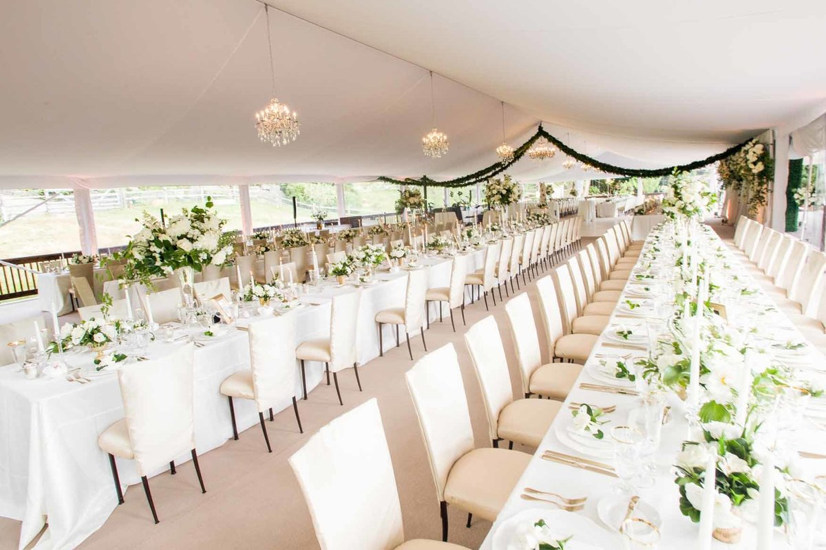 Wedding reception in large white tent on private estate in Seattle.
