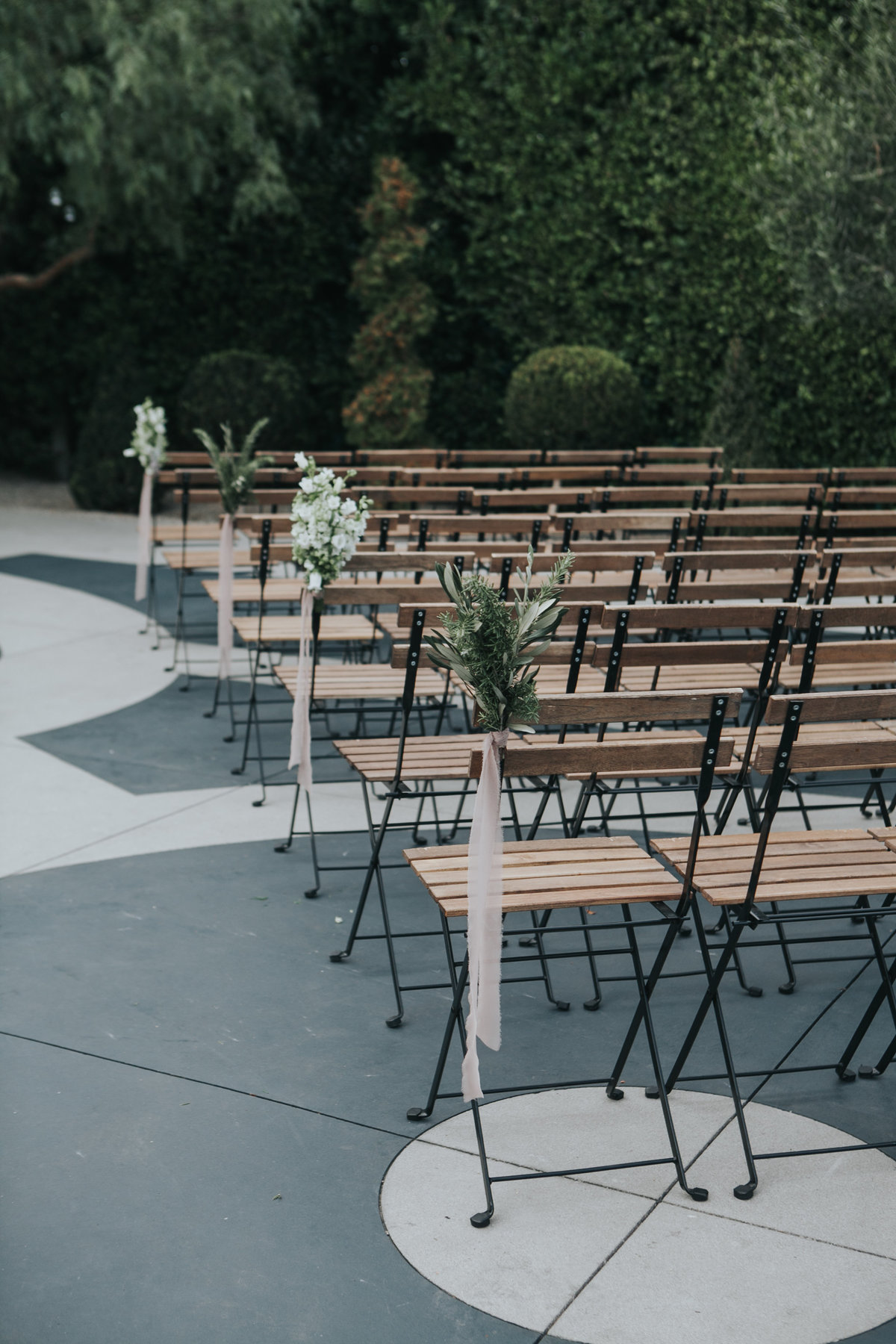Minimalist wedding ceremony with ribbon aisle markers at The Fig House
