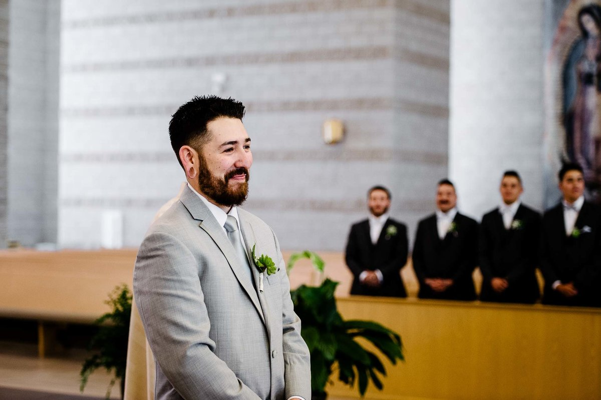 groom waiting for his bride at saint stephen church in el paso