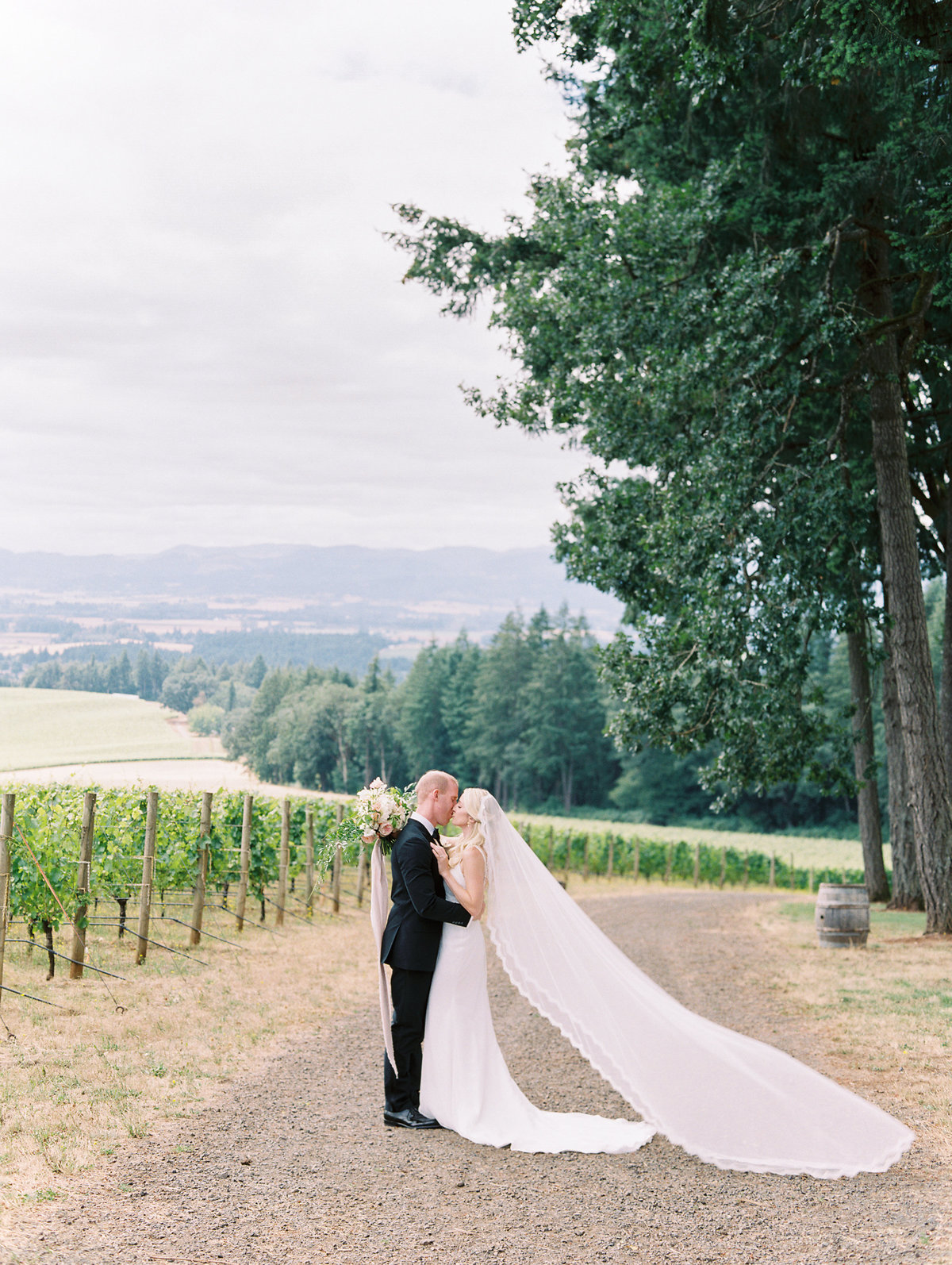 bride and groom kissing at vista hills vineyard