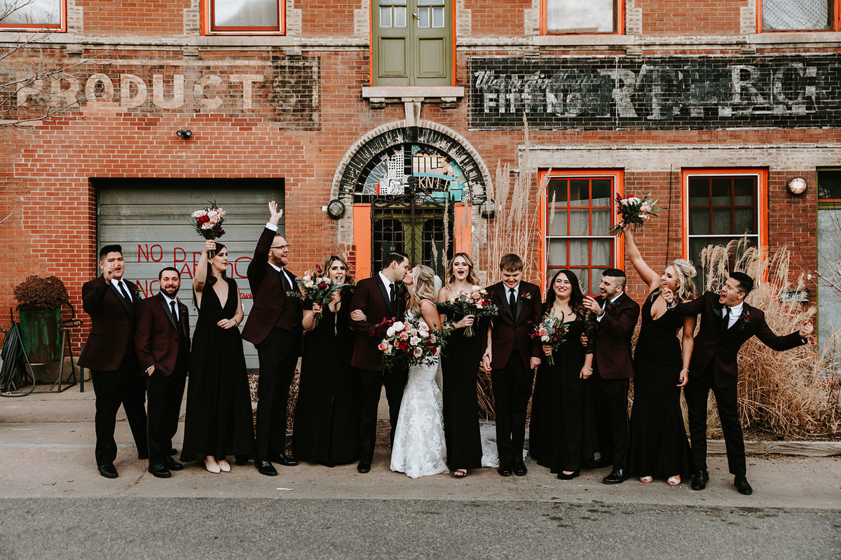 wedding party outside of Bigsby's Folly in RINO district in Denver Colorado