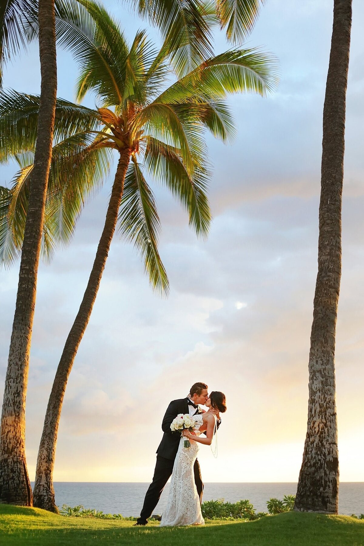Bride and groom kiss after their wedding at Andaz Maui Resort in Wailea
