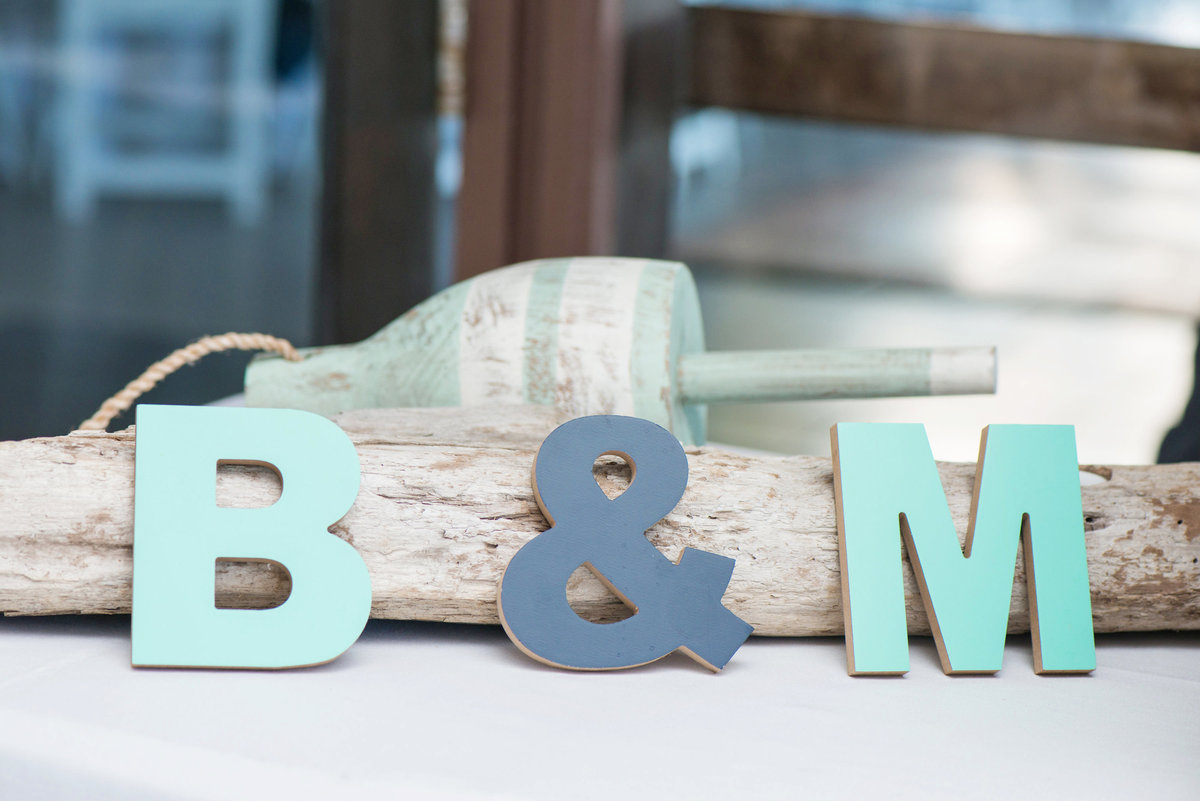 engraved letter decorations of bride and groom initials from wedding at Pavilion at Sunken Meadow
