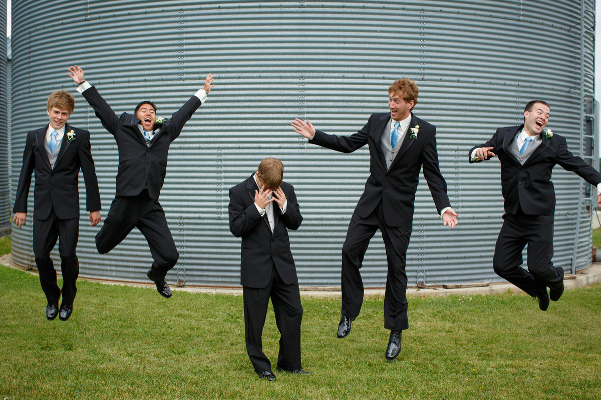 jumping wedding party while the groom is super embarrassed about it