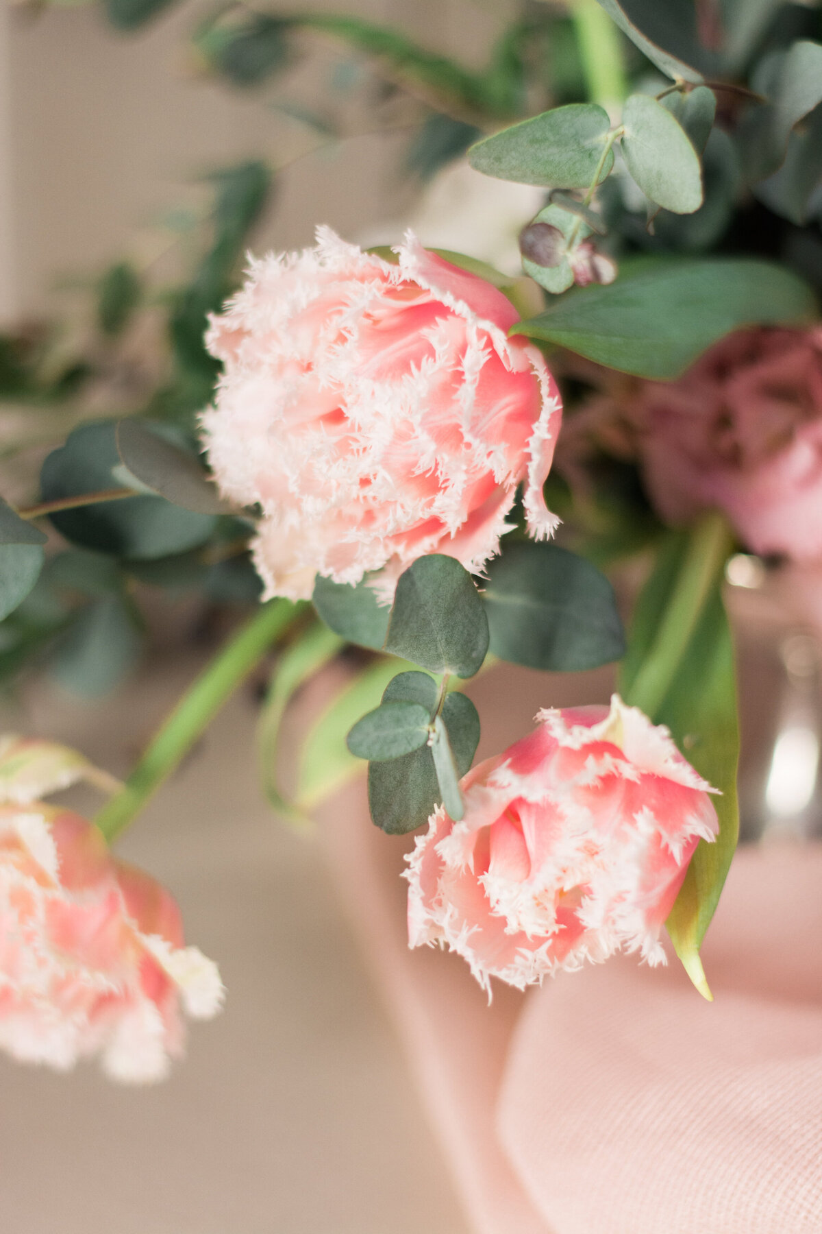 Close up of pink flowers in wedding centerpiece
