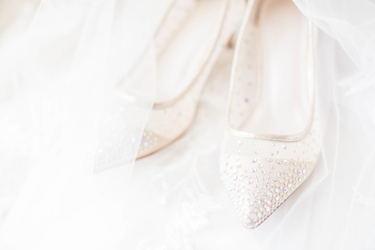 off white sequin wedding shoes surrounded by tule