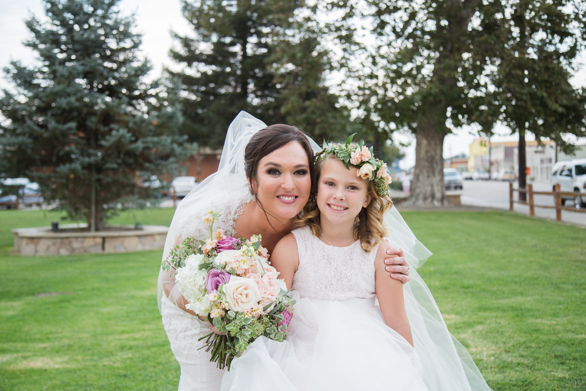 Bride and flower girl at 1880 Union Hotel Wedding