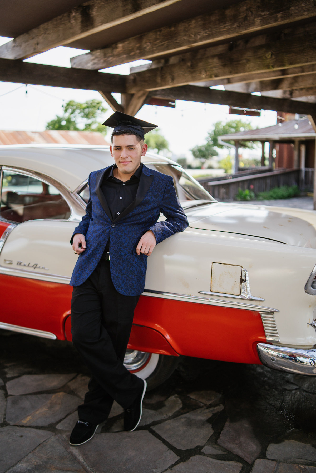 high school senior guy leaning on classic car