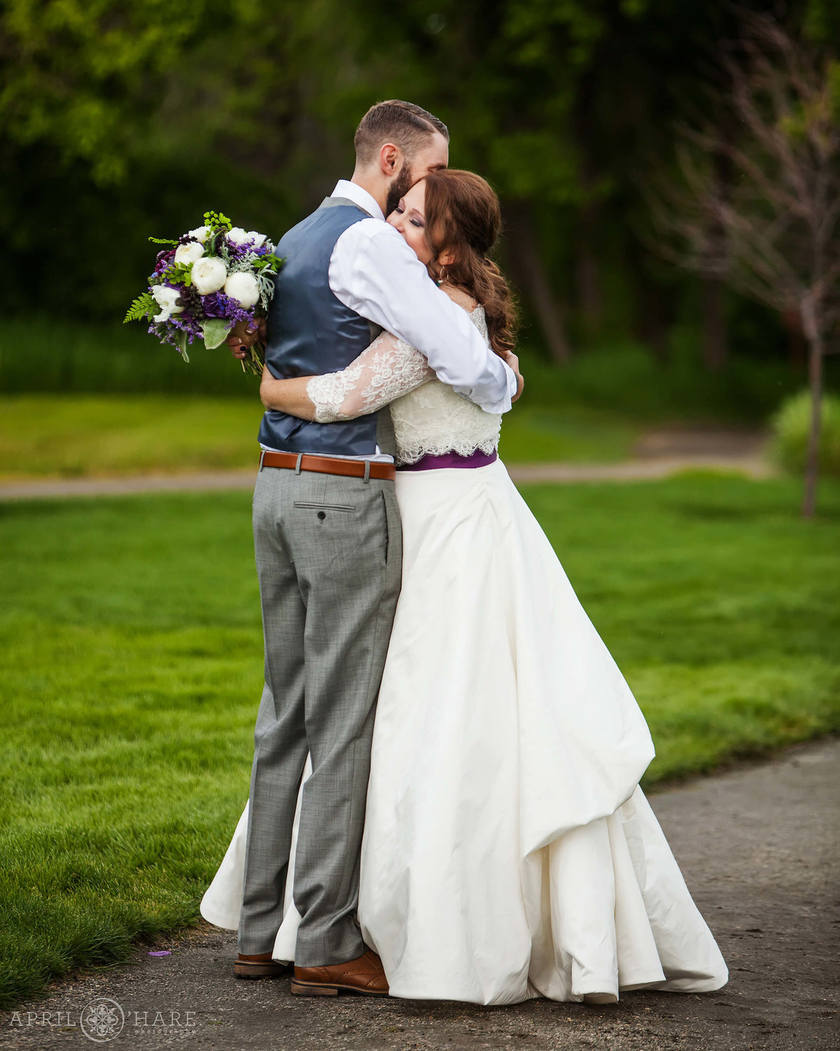 Sweet hug moment after wedding ceremony  at Chatfield Farms in Colorado