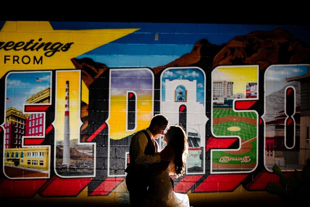 bride and groom portrait with el paso mural at 150 sunset in el paso by stephane lemaire photography