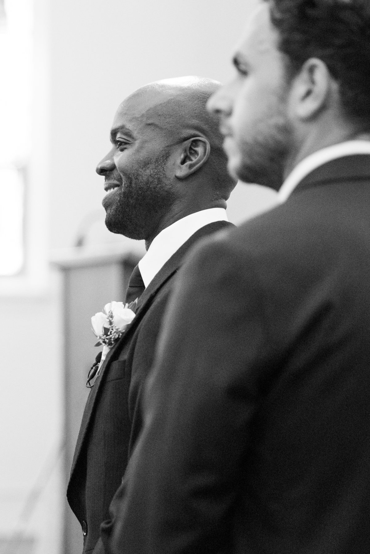 Groom seeing his bride for the first time at their wedding in Thunder Bay