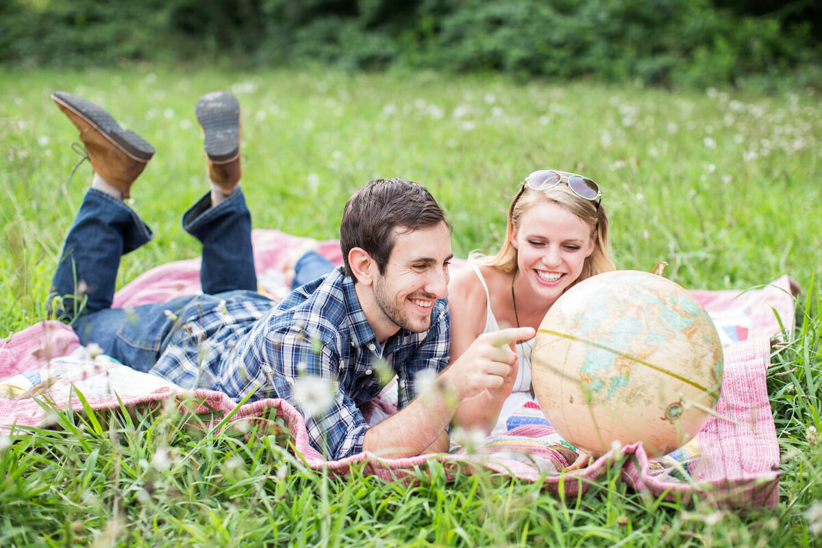 engaged couple having a spring picnic
