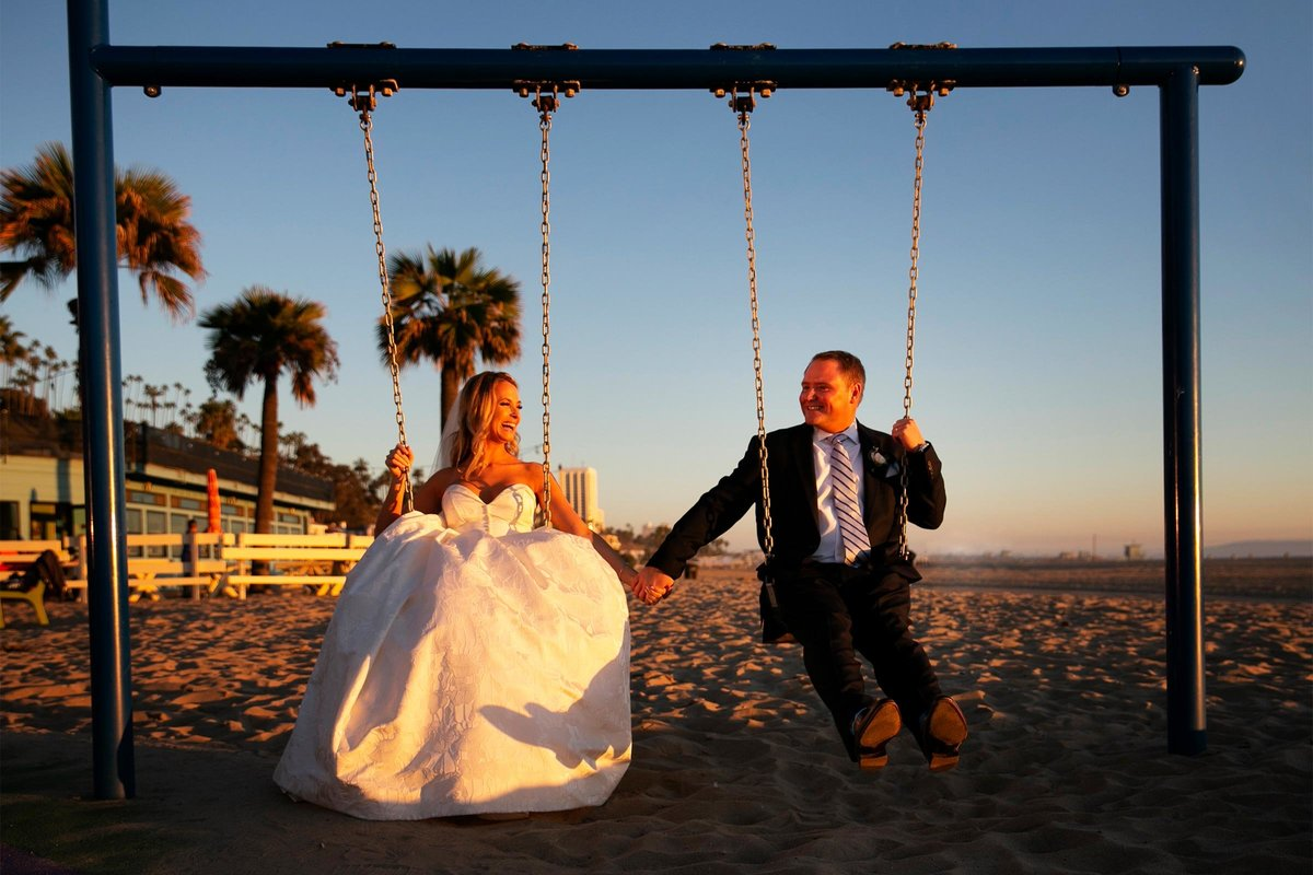 bride groom swings at annenberg community beach house in santa monica