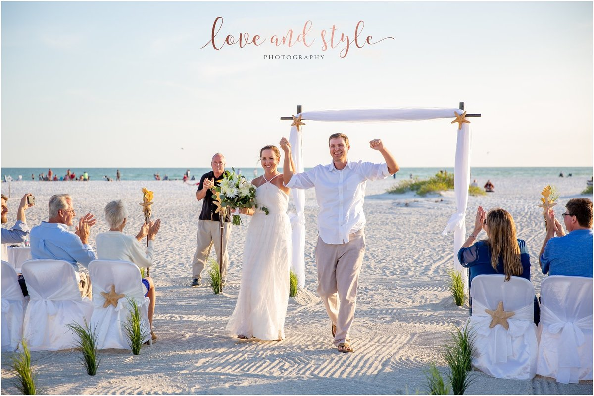 Lido Beach Wedding Photography of bride and groom celebrating after pronounced husband and wife