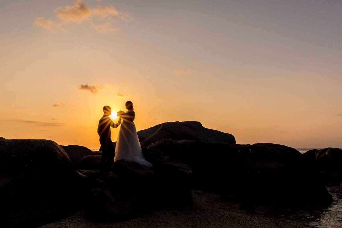 Couple standing on rocks at Sai Nuan beach,| Koh Tao