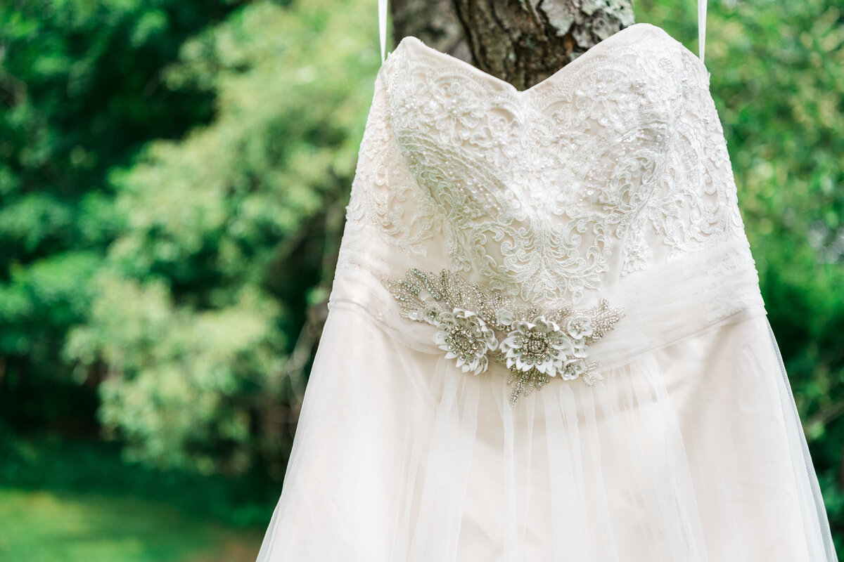 Hanging wedding dress at outdoor Boston Wedding Ceremony