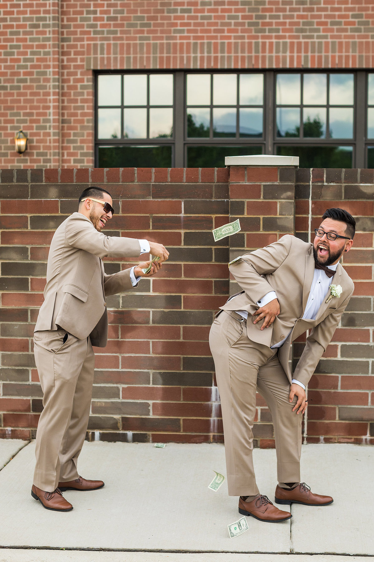 groom getting dollar bills thrown at him