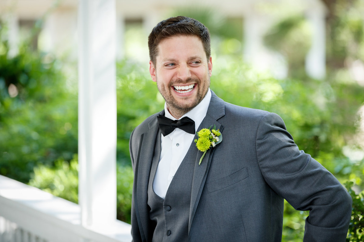 Austin wedding photographer casa blanca on brushy creek groom smiling