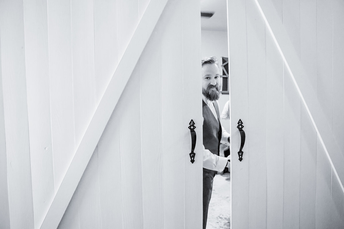 Austin Family Photographer, Tiffany Chapman Photography groom looking out a door photo