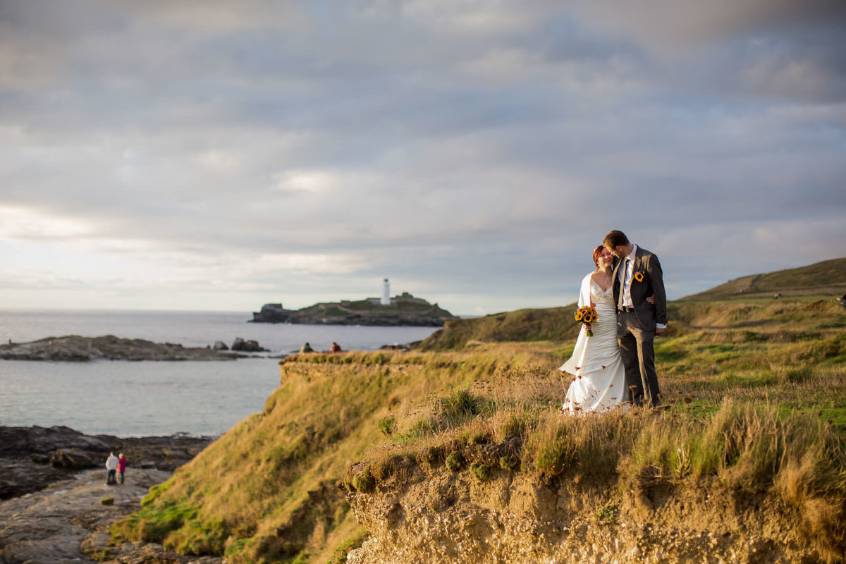 Wedding couple on cliff top at Cornish Wedding