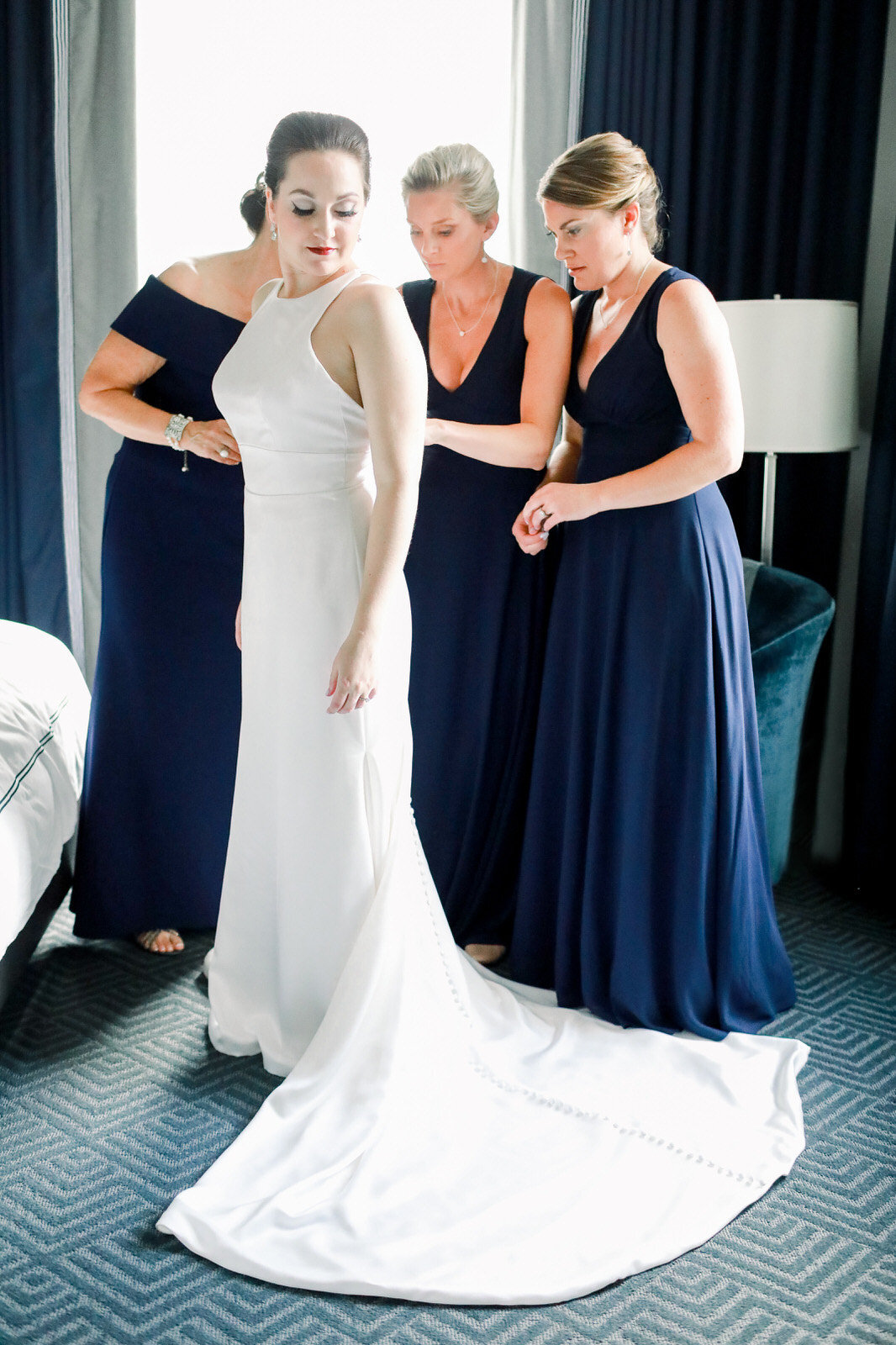 A fine art Winston Salem wedding photographer captures a bride getting ready for her Forsyth Country Club wedding.