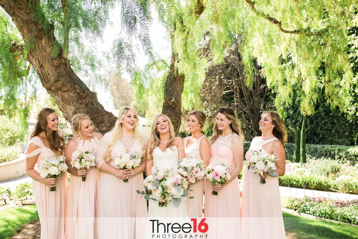 Bride and Bridesmaids share a laugh on the grounds of the Richard Nixon Library