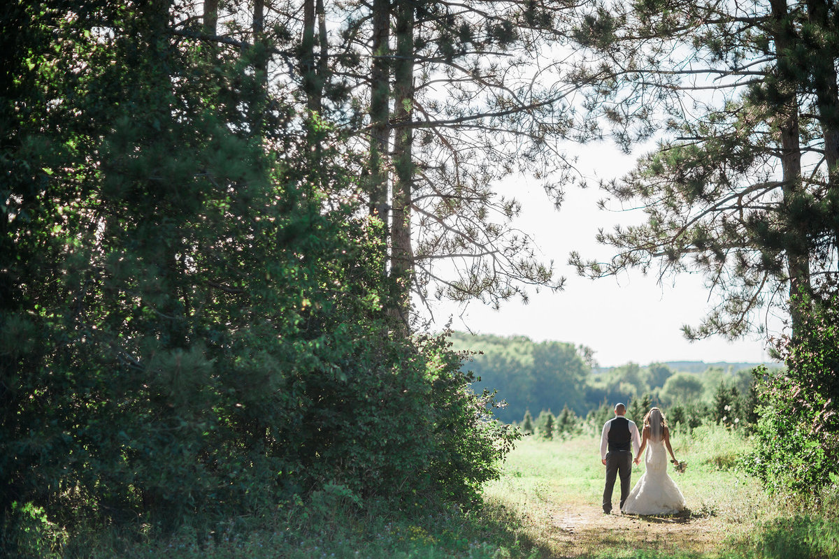 bride and groom in forest at williams tree farm