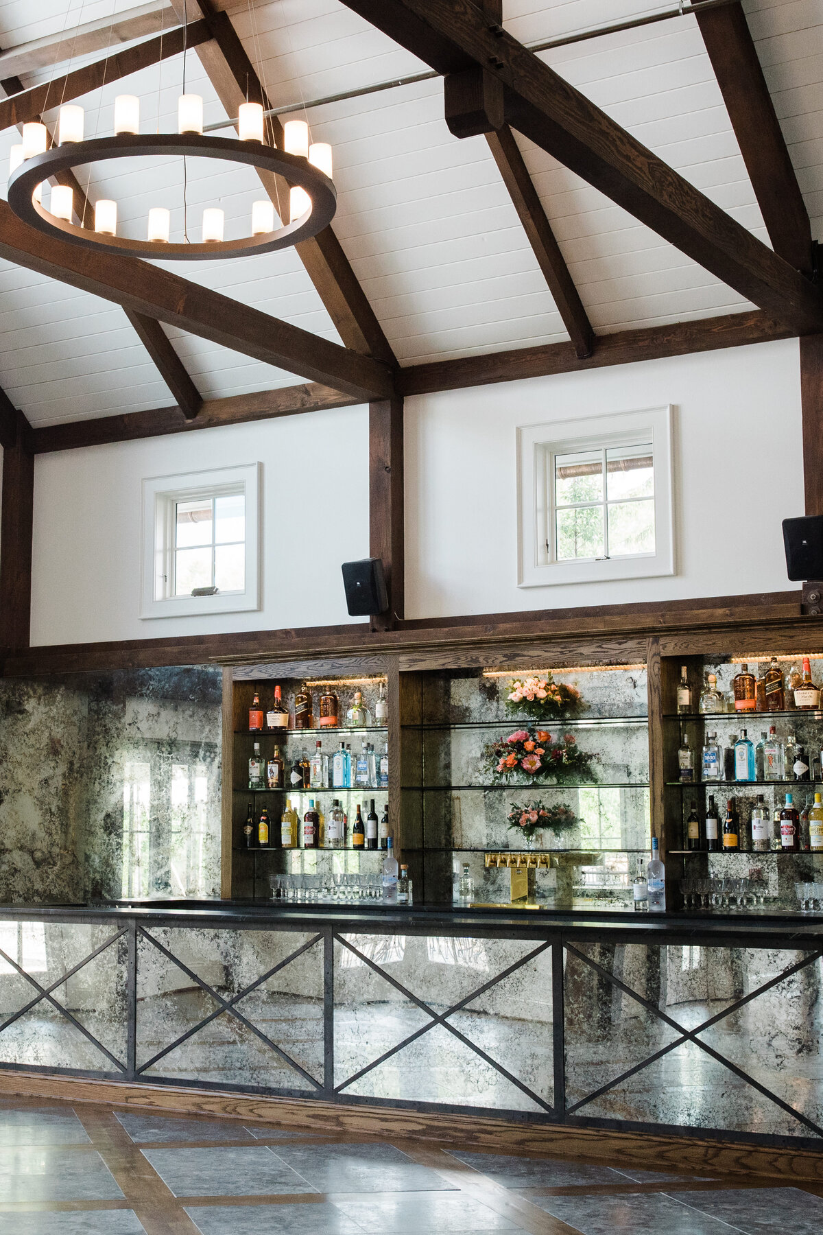 Stunning mirrored bar space in the the farmhouse reception space