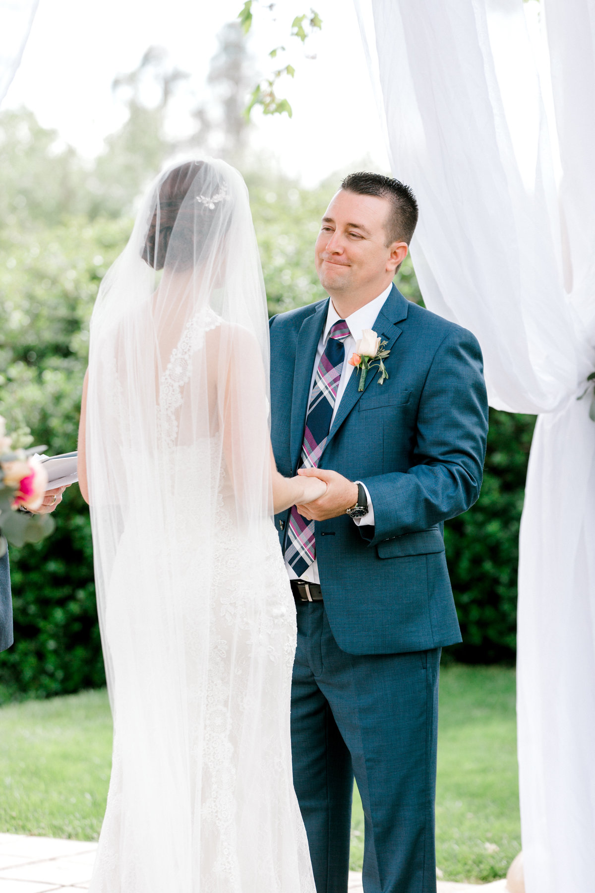 Groom and bride during ceremony at Vintners Inn in Santa Rosa California
