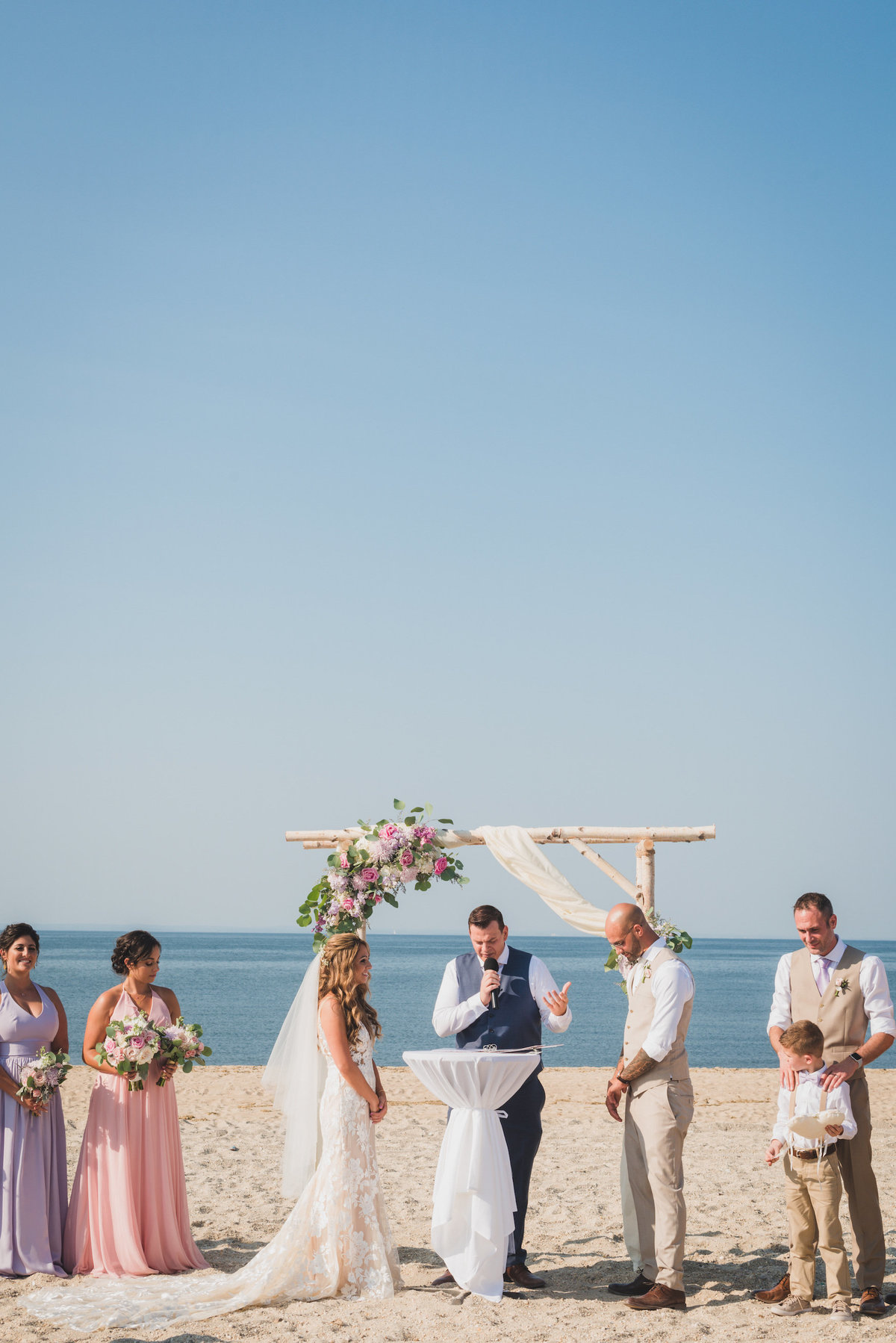 photo of ceremony on the beach from wedding at Pavilion at Sunken Meadow