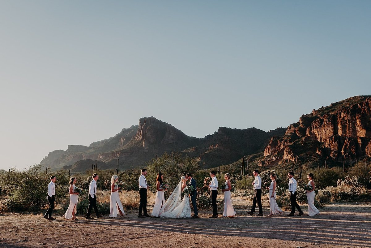 Wedding party lined up and walking together in the Phoenix desert