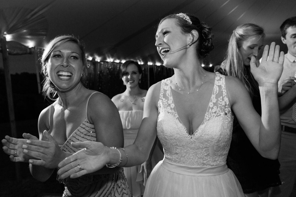 The bride dances with her friends at her tented reception in Hampton Falls New Hampshire
