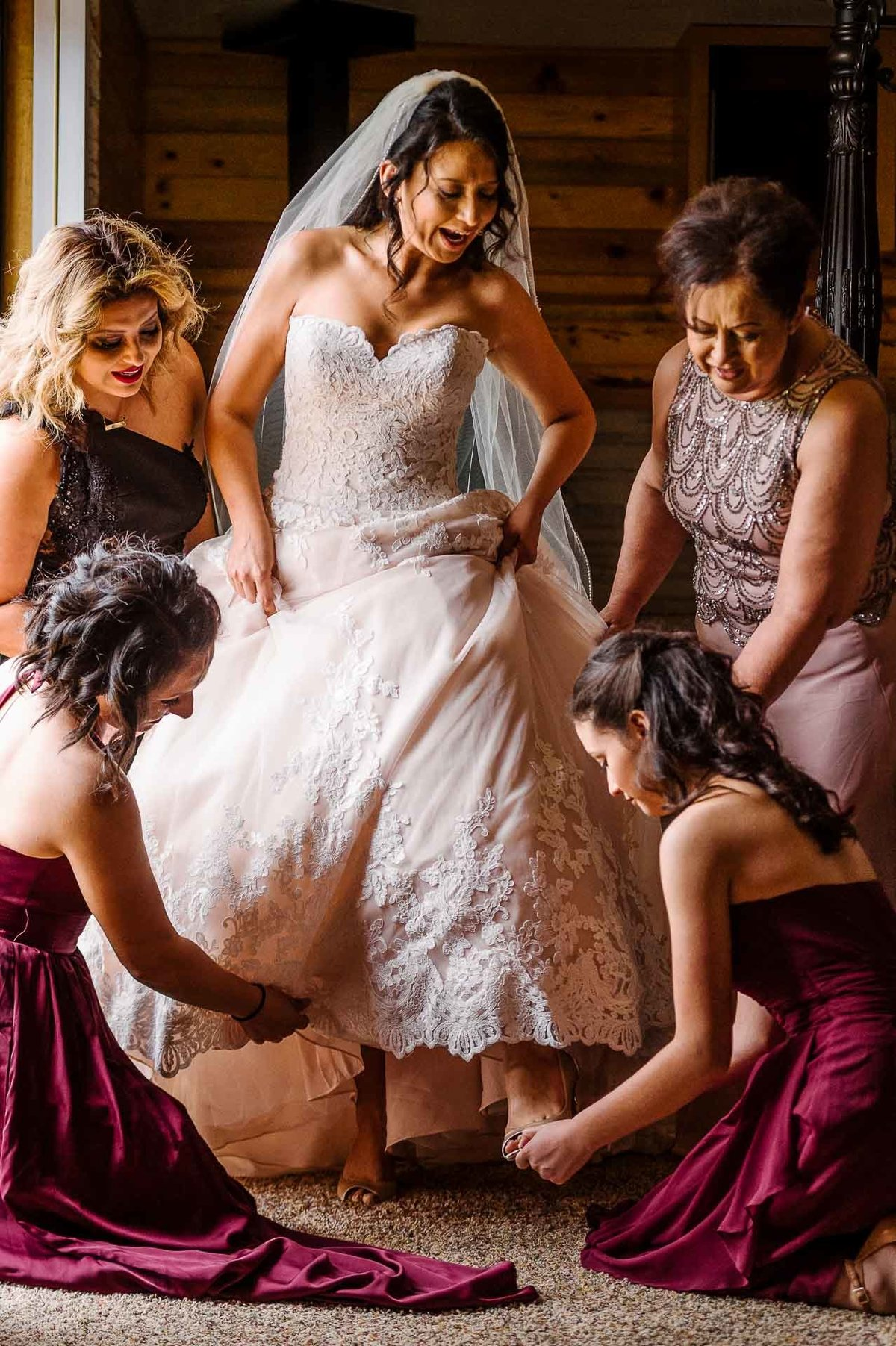 bridesmaids helping bride getting ready by stephane lemaire photography