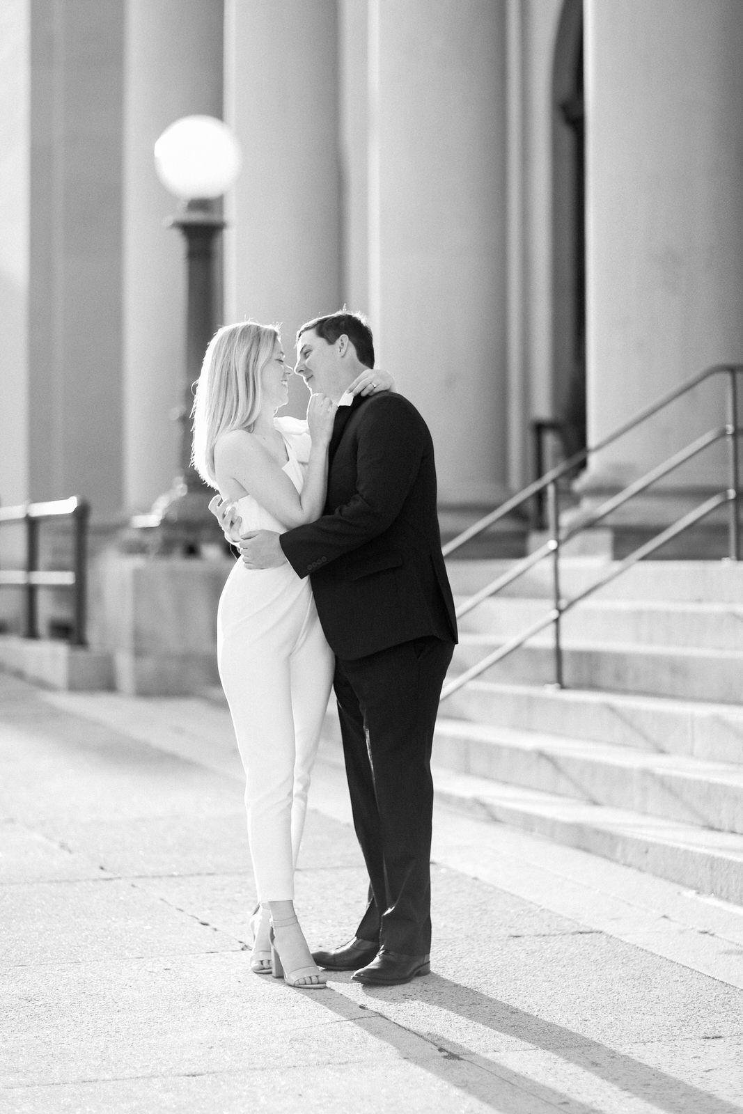 DC Wedding photographer photographs a stylish and classic couple during their downtown engagement photography session before their modern wedding.