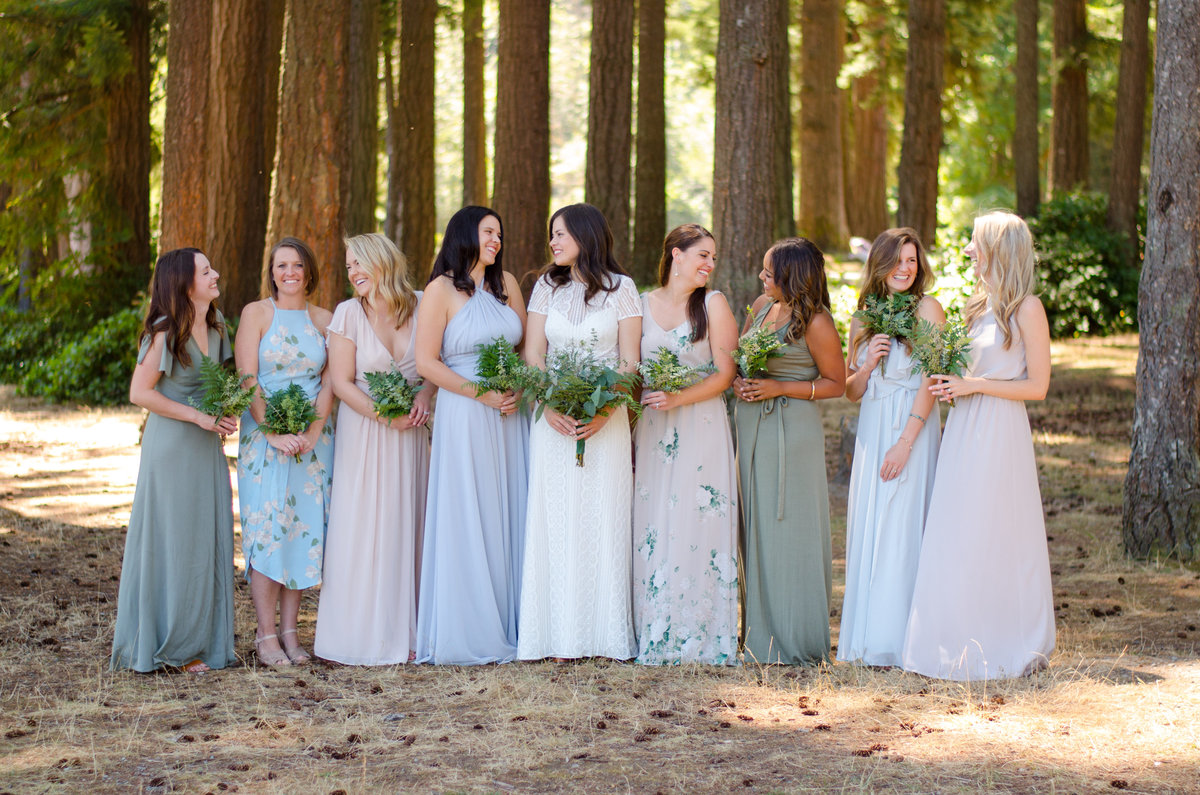 Bride with bridal party in woods