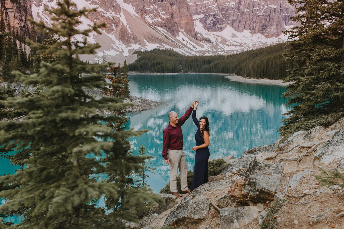 stunning couples portrait in front of Moraine Lake captured by top banff photographer